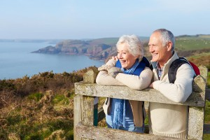Couple walking along the Cornwall Coastline